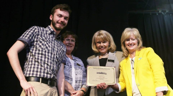 Graduate Dylan Engle, Mrs. Judy Smith, Mrs. Sharon Ball, and Dr. Connie Hodge